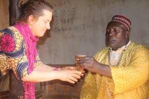 DeLuca receiving palm wine from Shufai in Cameroon