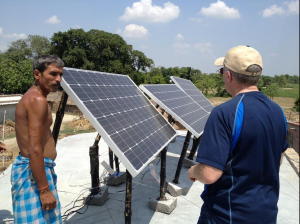 Brad_Mattson_installing_solar_panels_in_an_off-grid_Indian_village,_June_2013_